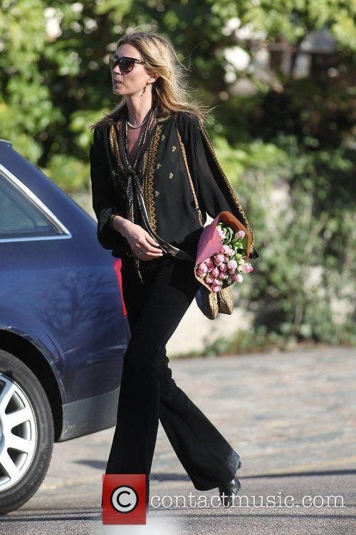 Kate Moss  out and about near her...