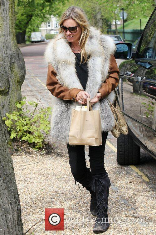 Kate Moss arriving at her house London, England