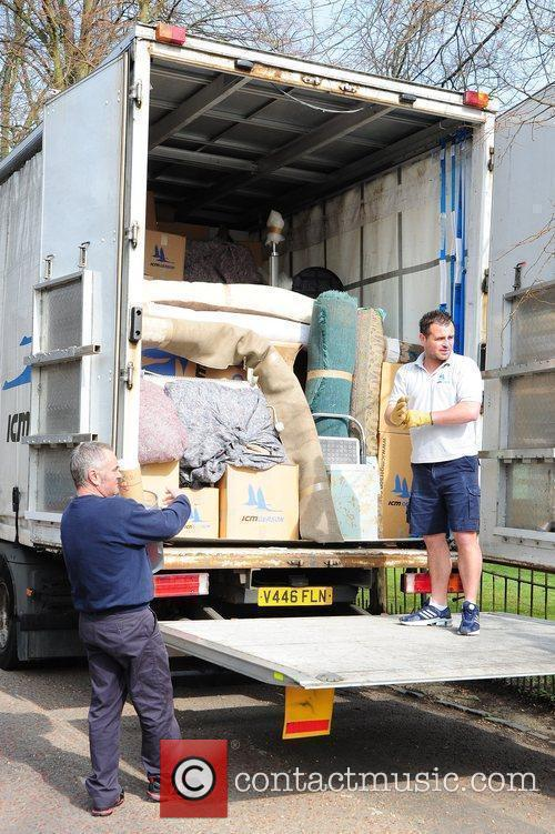 Removal men taking Kate Moss' belongings to her...