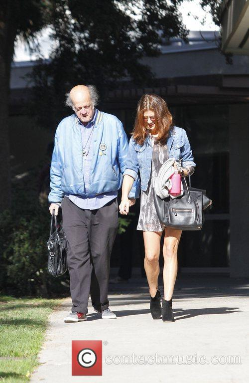 Kate Walsh seen walking with an elderly man...