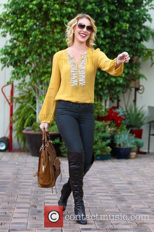 katherine heigl takes a flower from a 5956768