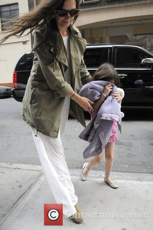 Katie Holmes and her daughter Suri Cruise are...