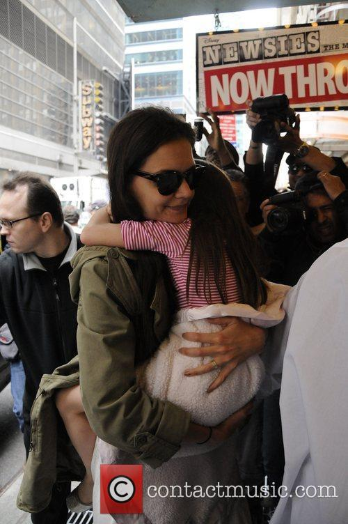 Katie Holmes and daughter Suri Cruise arrive to...