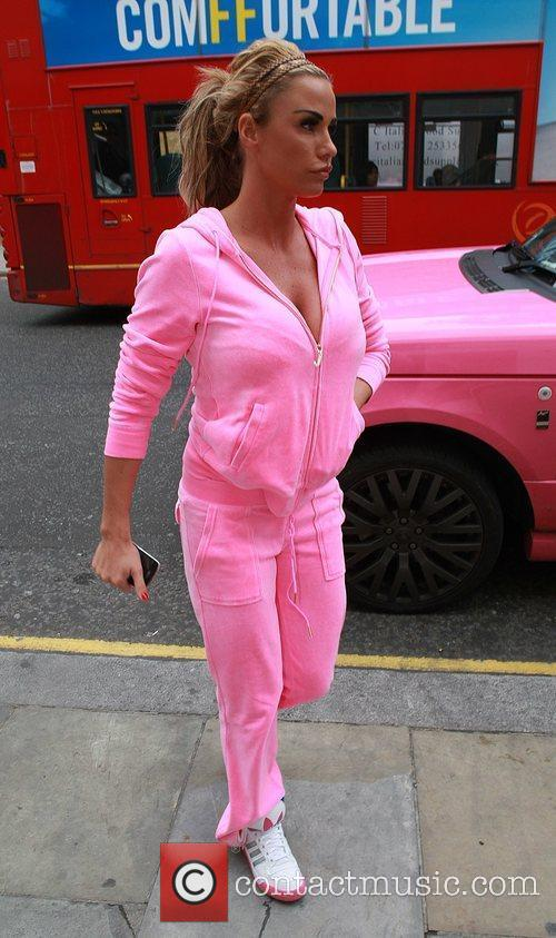 Katie Price stops into a bank and retrieves...