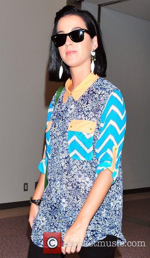 Katy Perry arrives at Narita International airport ahead...