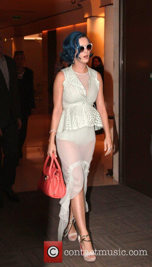 Katy Perry  leaving her hotel and posing...