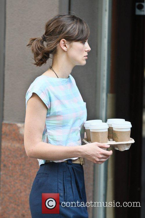 Keira Knightley filming on the set of her...