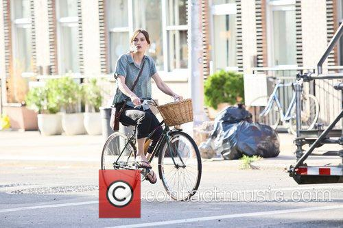 Rides a bicycle during a scene for her...
