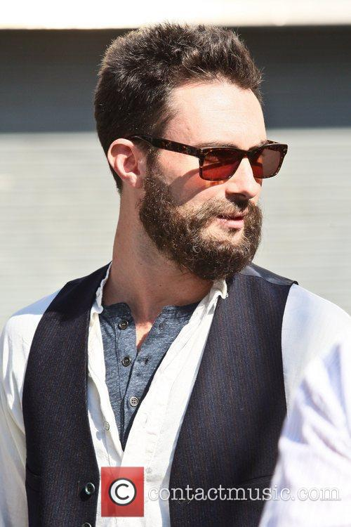 Adam Levine filming on the set of their...