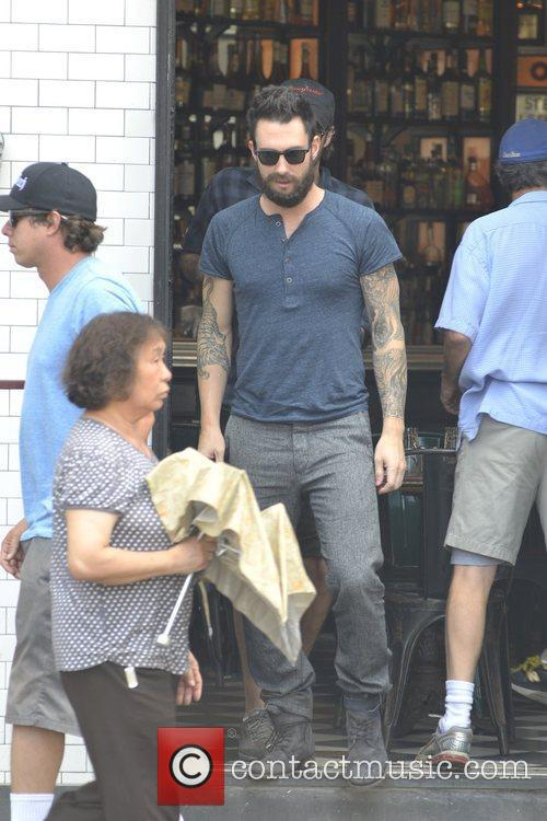 Adam Levine filming on the set of thenew...