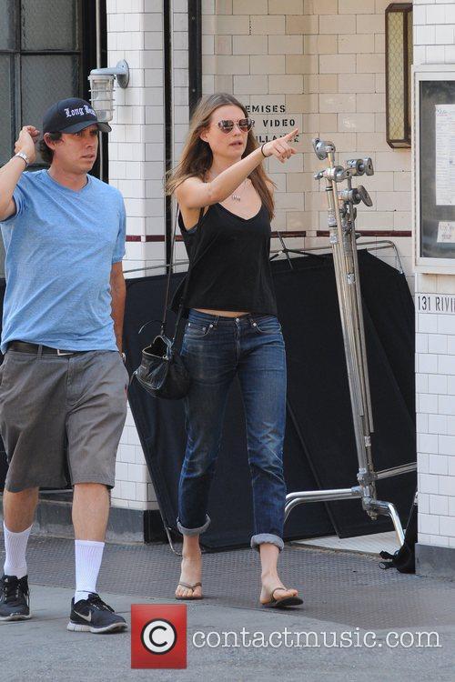 Behati Prinsloo on the set, with her boyfriend,...