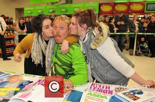 Keith Lemon aka Leigh Francis signs copies of...