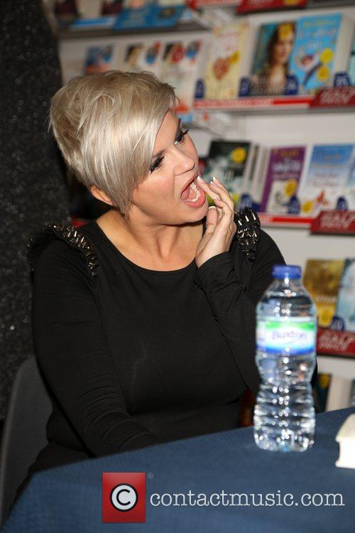 Signs copies of her new book 'Still Standing'...