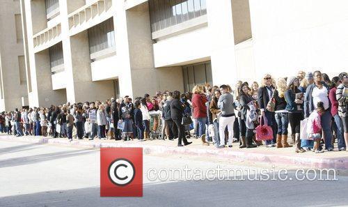 Fans queue Khloe Kardashian attends a toy drive...