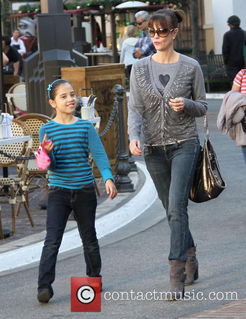 Goes shopping with her daughter at The Grove...
