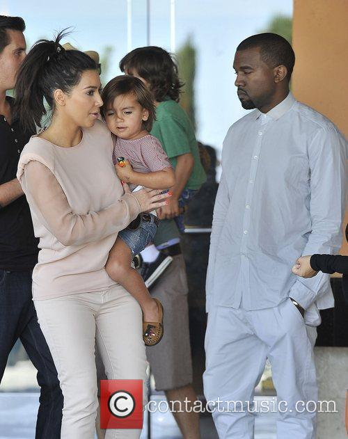 Kim Kardashian, Kanye West and Mason 3