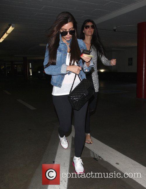 kim kardashian leaving a parking garage wearing 3817643