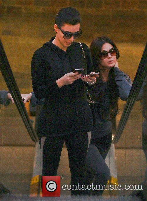 kim kardashian is engrossed in her two 3704465