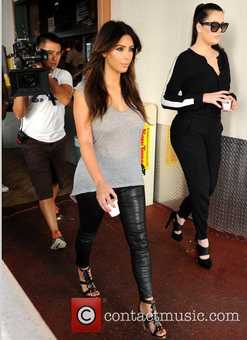 kim kardashian and khloe kardashian leaving a 5932776