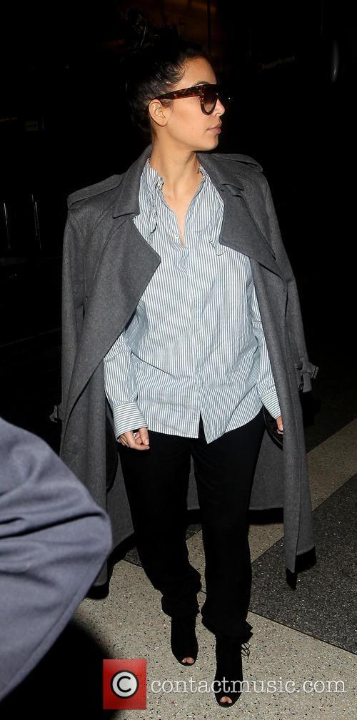 Kim Kardashian Pregnant Kim Kardashian arrives at LAX...