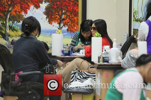 kim kardashian has a manicure followed by 3680726