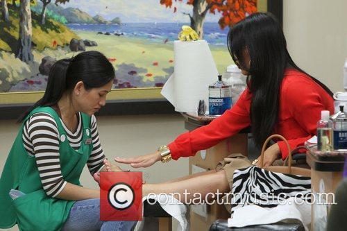 kim kardashian has a manicure followed by 3680742