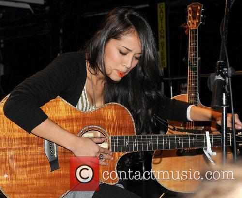 Performing live on stage at The Academy in...