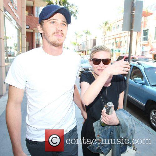 kirsten dunst and garrett hedlund arriving at 3881415