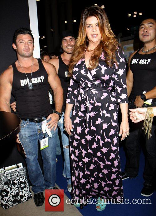 Kirstie Alley poses with male models Kirstie Alley...