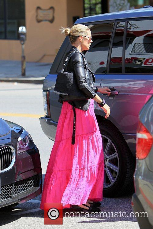 Heidi Klum, is seen in good spirits after...