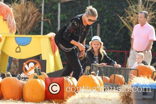 Heidi Klum spends the day picking pumpkins with...