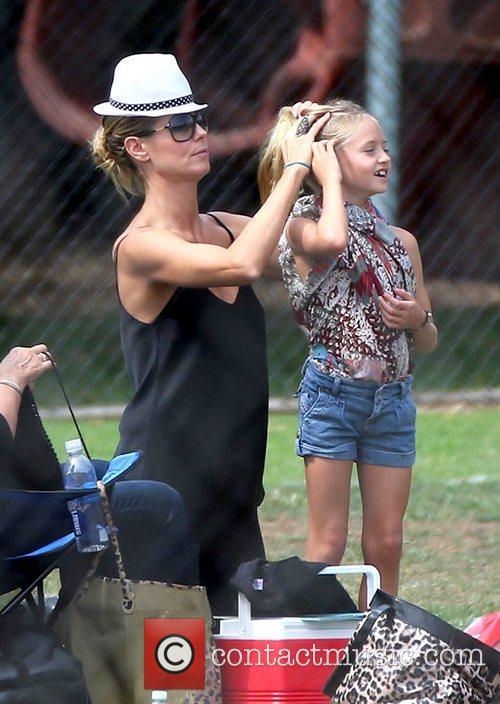 Heidi Klum fixing her daughter Leni Samuel's hair...