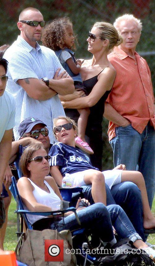 Martin Kristen and Heidi Klum holding her daughter...