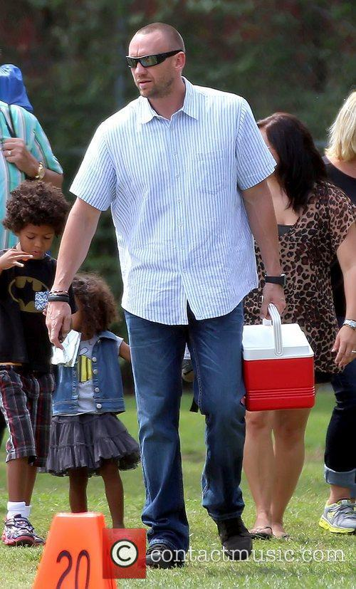 Martin Kristen watches his girlfriend's son's soccer game...