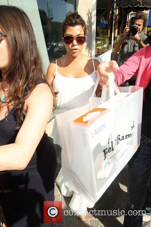 Pregnant Kourtney Kardashian  leaving with bags from...