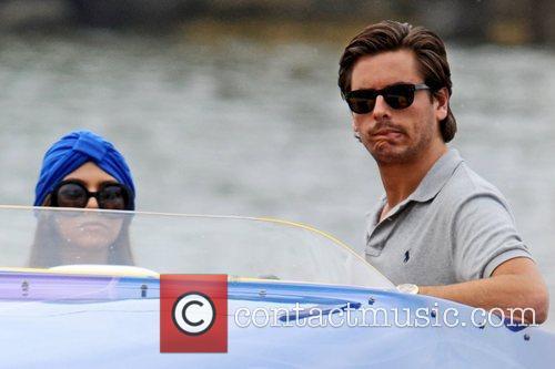 Wearing a turban, seen with boyfriend Scott Disick...