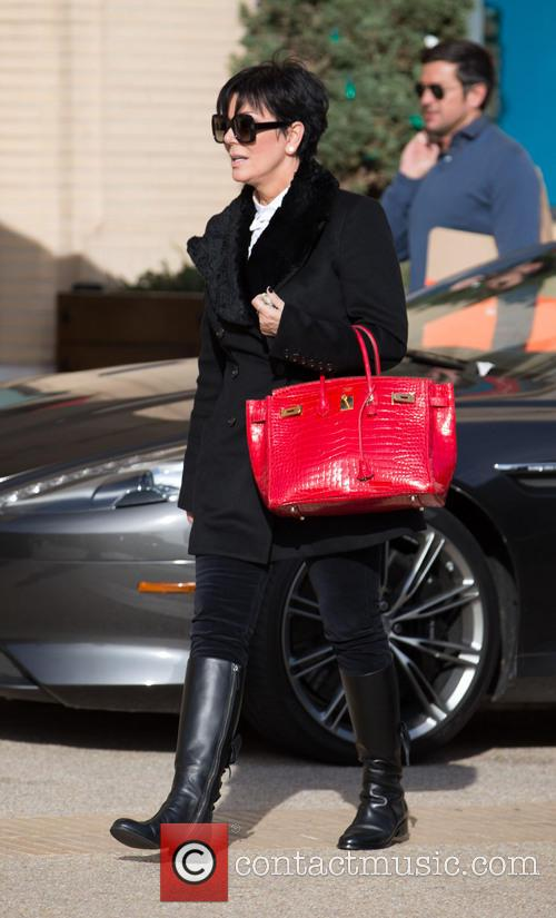 Kris Jenner returns to her car after shopping...