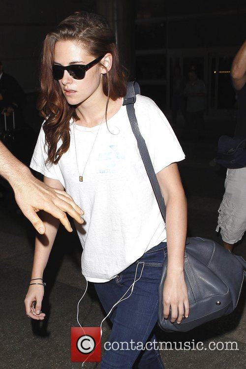 Arrives at LAX airport