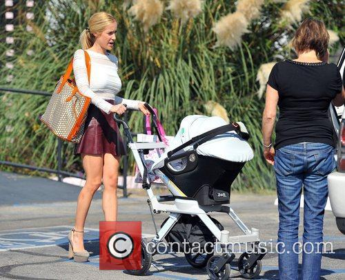 Pushes her son Camden Jack Cutler in a...