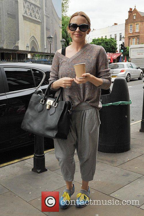 Arrives at a dance studio in West London