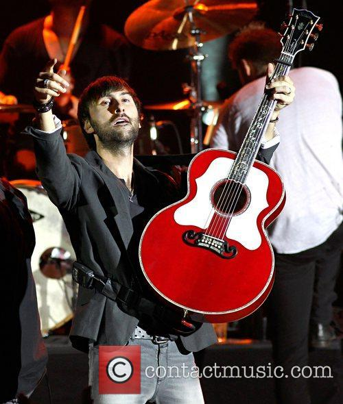 Dave Haywood of Lady Antebellum performing on stage...