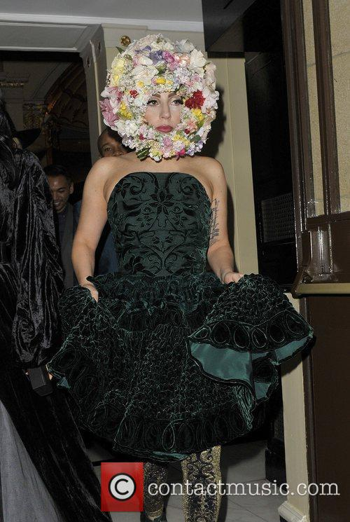 Lady Gaga leaving her hotel wearing a green...