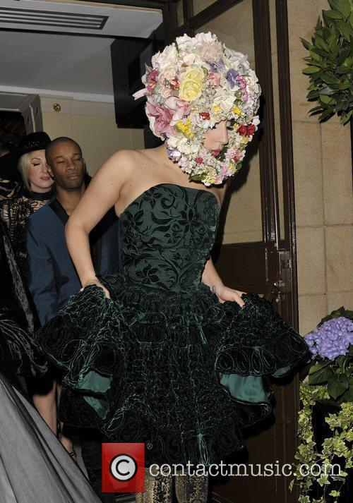 Leaving her hotel wearing a green dress and...