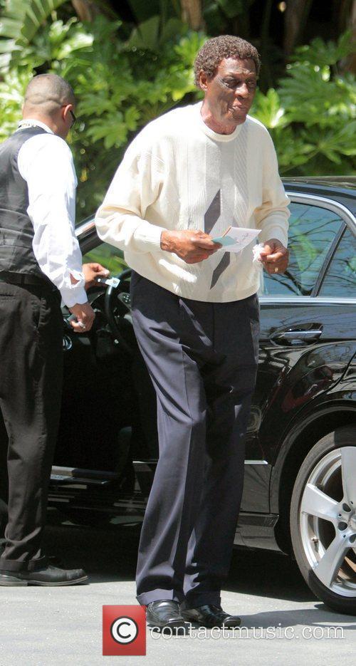Elgin Baylor,  arriving at the Los Angeles...