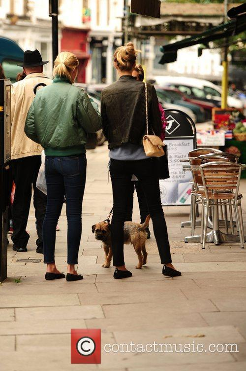 Lara Stone walks her dog in Primrose Hill....