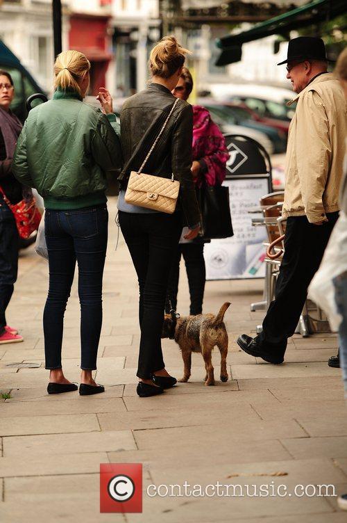 Lara Stone walks her dog in Primrose Hill....