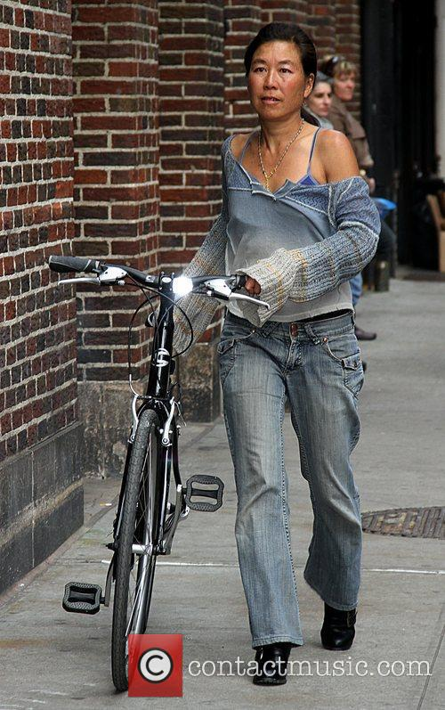 Wheeling her bicycle in Manhattan