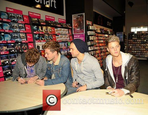 Lawson sign copies of their debut single 'When...