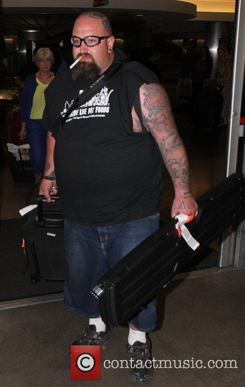 Carries a gun case as he arrives at...
