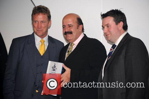 Willie Thorne collecting the winner's prize on behalf...